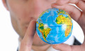 RebeccaLewis_May2014_global-world-in-hands-shutterstock