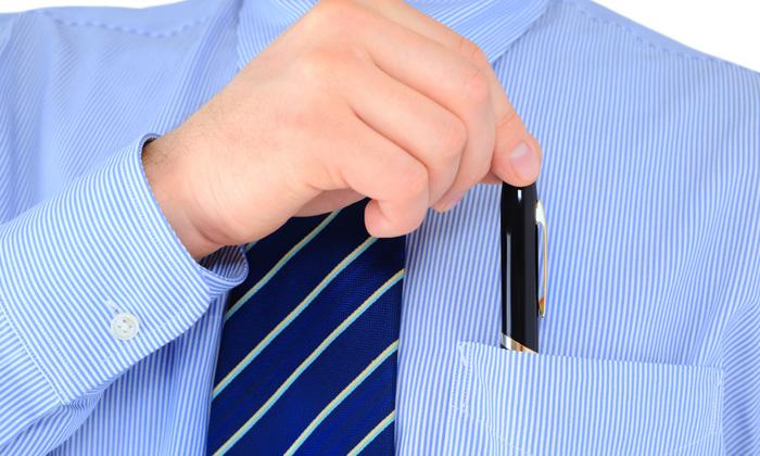 Rebeccalewis june2014 businessman stealing pen in pocket shutterstock