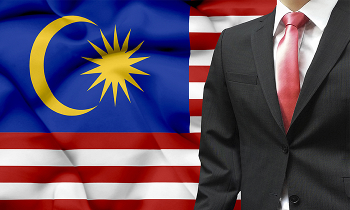 Malaysia flag businessman setting to show Malaysia has highest number of HR in the world
