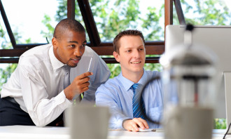 Businessmen mentoring each other to show mentoring can help in retaining talent