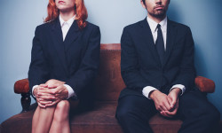 Woman and man wait for interview