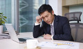 Tired businessman to show depression affecting China employees