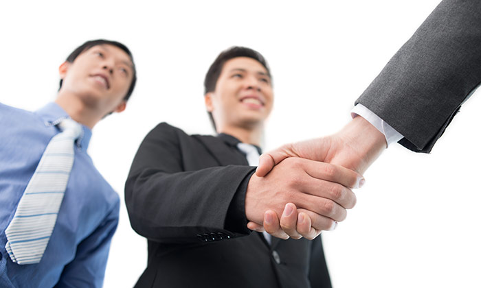 Asian handshake to show hiring in Hong Kong set to increase