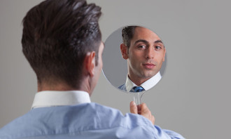 businessman looking in the mirror