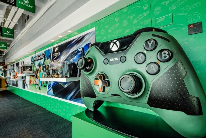 Xbox wall showcases the latest Xbox One, accessories, premium gifts, special edition cross-over designs with brands and exhibits of the Xbox-exclusive game Halo.