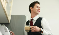 26386979 - businessman making coffee in the office pantry