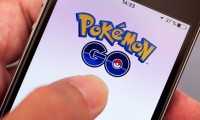 Person hand starting Pokemon Go application on apple iPhone5s