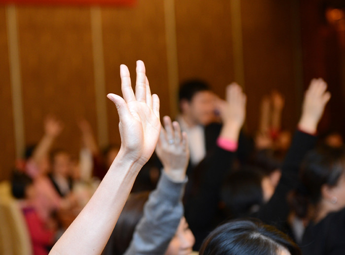 23086588 - raised hands in class of university