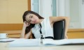 Bored business woman looking very boring at her desk