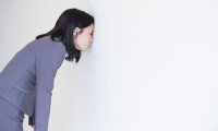 Employee banging head against the office wall, hr