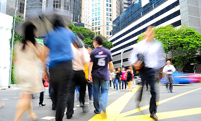 Singaporeans crossing the road in CBD