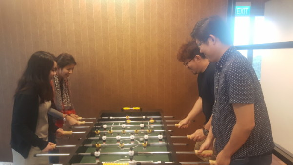 HomeAway employees playing foosball