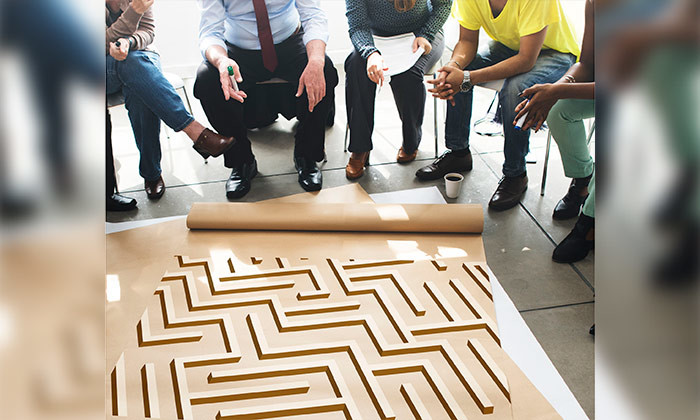 Recruiters working through a maze to find candidates