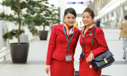 Cathay Pacific crew members posing in airport