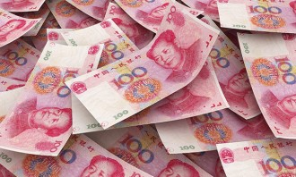 16514273 - chinese 100 yuan bill face within pile of other 100 yuan bills