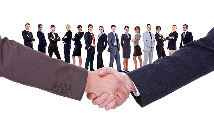 11188310 - handshakeof two businessmen  isolated on business background