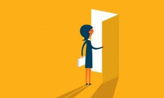 Employee standing in front of an open door, hr