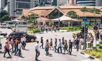 Singapore business people crossing street - iStock