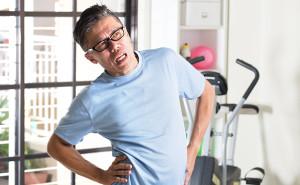 asian senior male having injury during gym workout