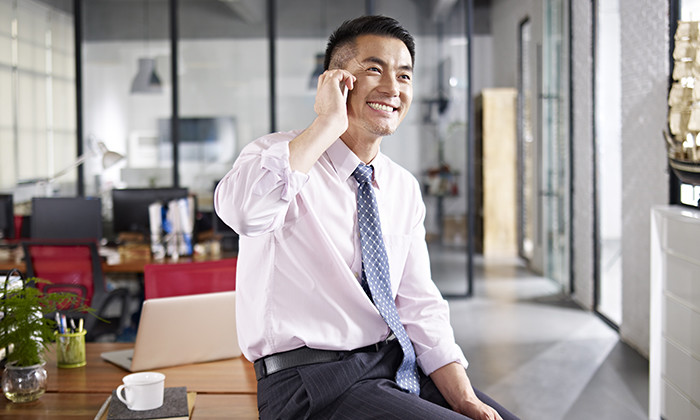 asian businessman talking on cellphone