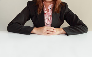 Interviewer sitting at a table, hr
