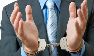 10877242 - white collar criminal under arrest