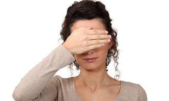 15807632 - woman covering eyes