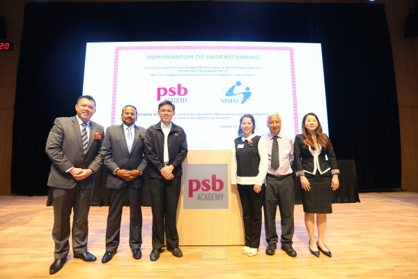 From left to right: Derrick Chang, CEO of PSB Academy; Viva Sinniah, executive chairman of PSB Academy; Chan Chun Sing; Joanne Chua, president of SISEU; Philip Lee, general secretary of SISEU; and Sylvia Choo, executive secretary of SISEU