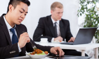 30935321 - diverse businessmen eating healthy meal in office