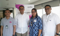 Mr. Tayag with (from left to right) Mr. Jobin Sigua, former Near Hire Training beneficiary and now Accenture employee; Ms. Ruth Binuya, Accenture employee volunteer; and Mr. Rey Laguda, Executive Director of the Philippine Business for Social Progress (PBSP).