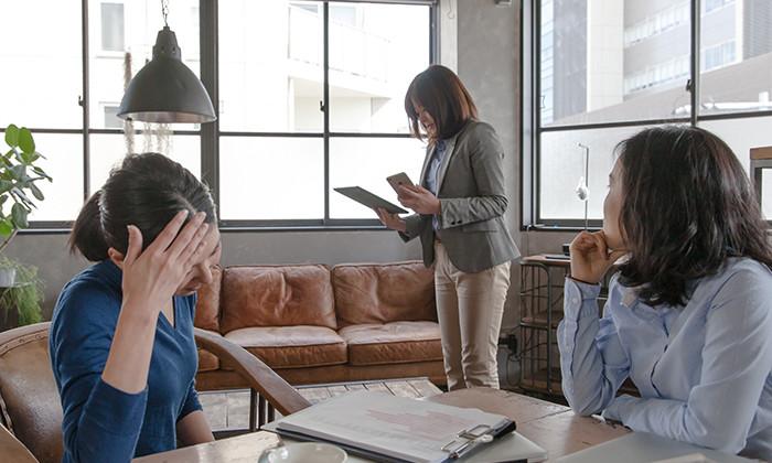 Colleagues in an open plan office, hr