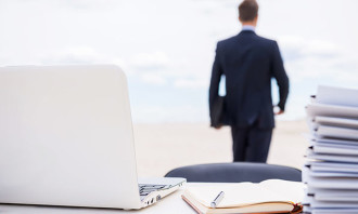 businessman walking away from desk - 123RF