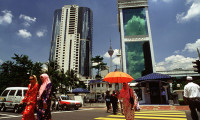 people walking in KL - 123RF