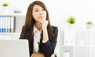 thinking asian business woman - 123RF