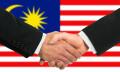 Malaysia businessmen shake hands