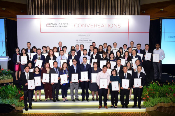 Lim Swee Say, Minister for Manpower, and the new batch of more than 50 HCPartners, recognised for their commitment to human capital development and adoption of progressive workplace practices.