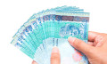 Malaysia ringgit held in hand