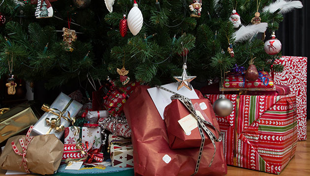 Christmas presents under the tree - 123RF