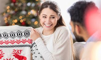 sad person opening Christmas gift - 123RF