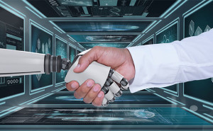 robot and human shaking hands - 123RF