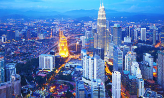 KL skyline with PETRONAS tower - 123RF