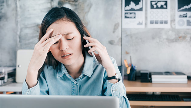 woman upset at work - iStock