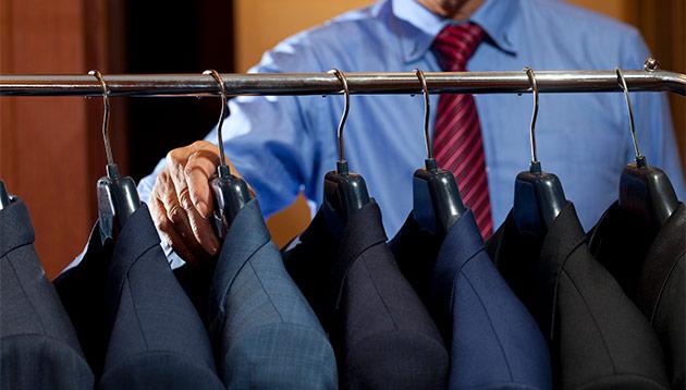Jerene - businessman choosing clothes - iStock